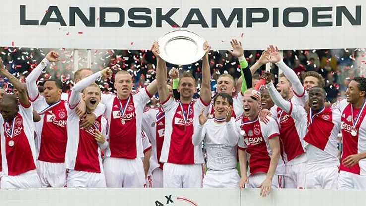 Ajax celebrate after securing the Eredivisie title.