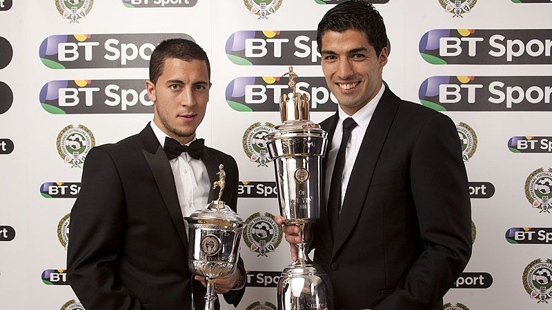 Eden Hazard and Luis Suarez pose with their PFA awards on Sunday evening.
