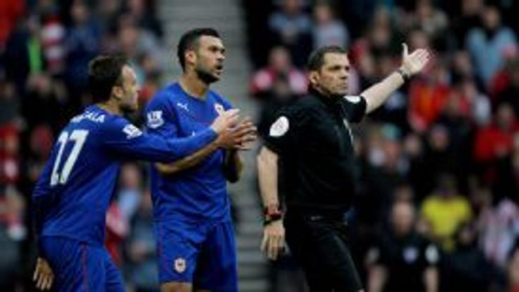 Cardiff defender Juan Cala is dismissed following a foul on Connor Wickham.