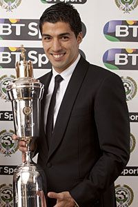 Luis Suarez poses with his PFA awards on Sunday evening.