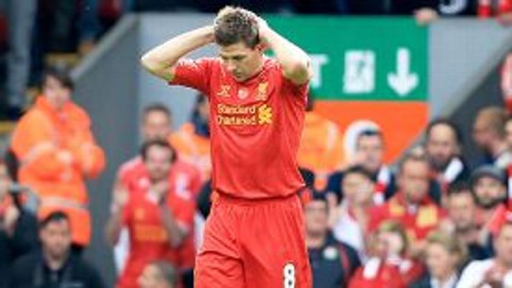 Steven Gerrard knows his mistake has handed a goal to Chelsea's Demba Ba.
