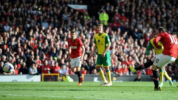 Wayne Rooney opens the scoring for Manchester United as Norwich slipped further into trouble.