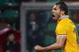 Carlos Tevez celebrates after getting the Juventus recovery started.