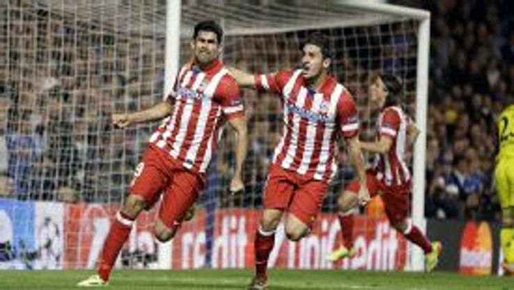 Diego Costa celebrates with Koke after scoring from the spot at Chelsea.