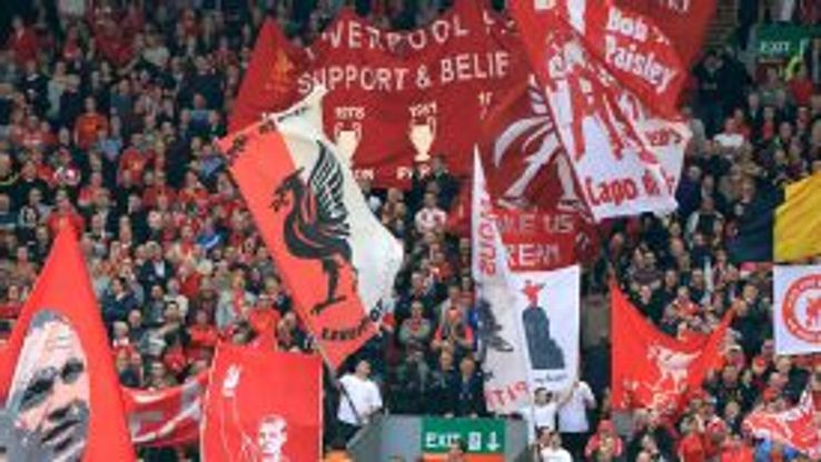 Liverpool fans support the team at Anfield.