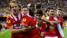 Stephane Mbia celebrates his winner with his Sevilla teammates.