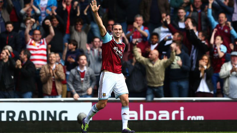 Andy Carroll wheels away after his header was deflected in by Harry Kane.