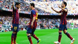 Dani Alves celebrates with Lionel Messi for Barcelona.