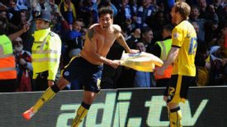 Leonardo Ulloa celebrates his winner.