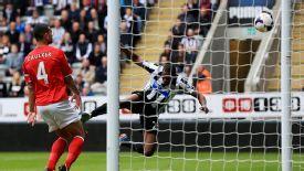 Shola Ameobi scores for Newcastle against Cardiff.