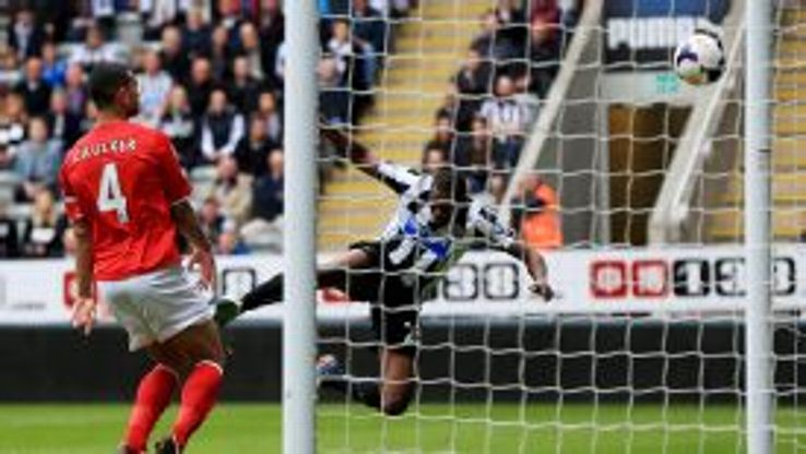 Shola Ameobi scores for Newcastle against Cardiff.