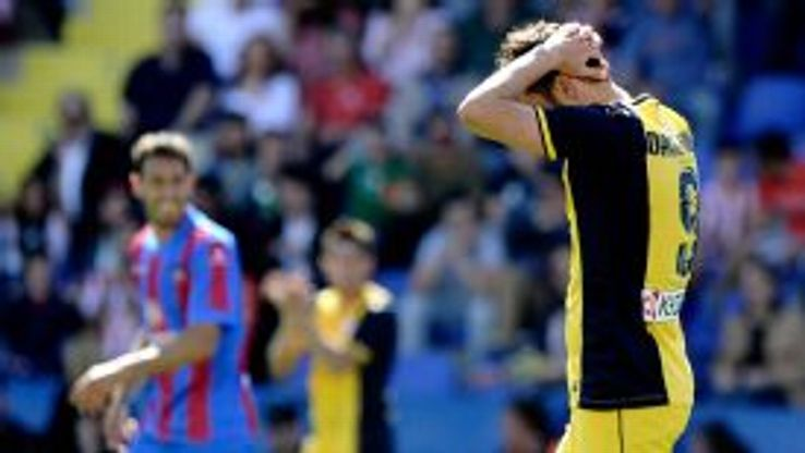 Atletico Madrid's forward David Villa reacts as Levante go ahead.