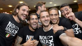 Carlos Tevez and his Juventus teammates celebrate claiming the title.