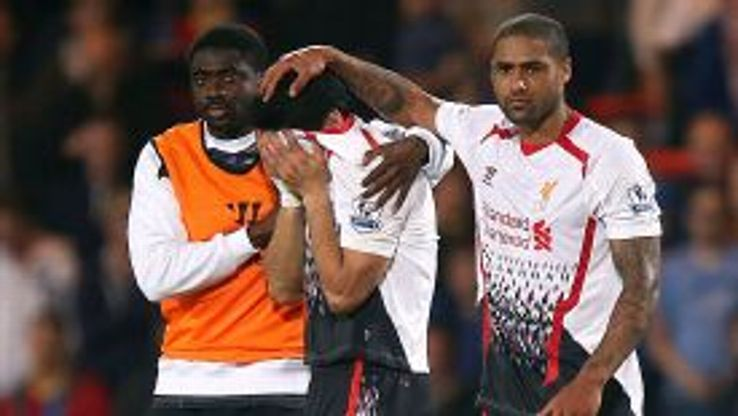 Kolo Toure and Glen Johnson try to console a crying Luis Suarez.