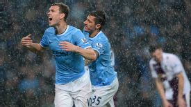Edin Dzeko celebrates a double strike.