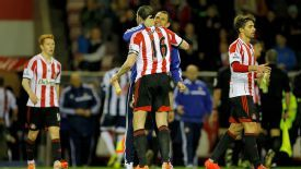 Sunderland manager Gus Poyet celebrates staying up with captain John O'Shea