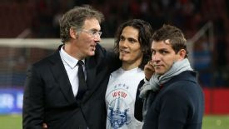 Laurent Blanc celebrates the title with PSG striker Edinson Cavani.