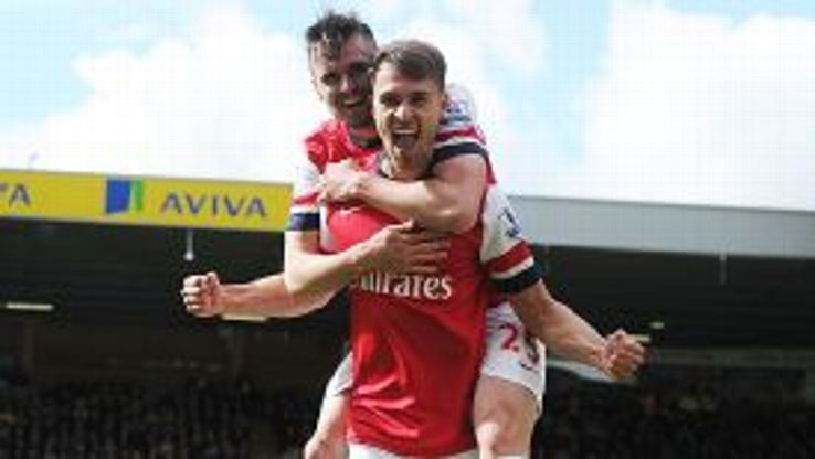 Carl Jenkinson celebrates with goal scorer Aaron Ramsey after Arsenal took the lead at Norwich.