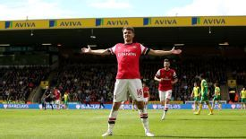 Aaron Ramsey celebrates his fine opener for Arsenal against Norwich.