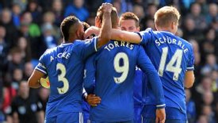Fernando Torres is mobbed after scoring Chelsea's winner at Cardiff.