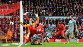 Daniel Agger acrobatically brings Liverpool back on terms with Newcastle.