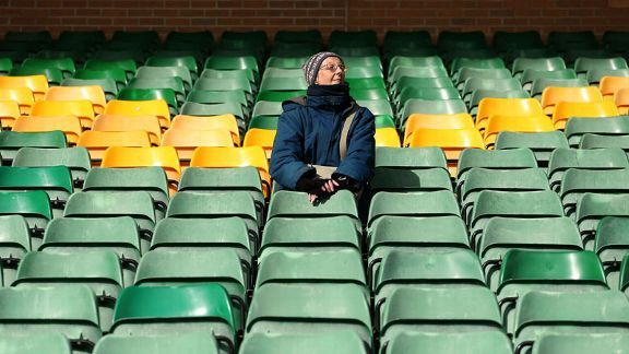 A lone Norwich fan contemplates life outside the Premier League.