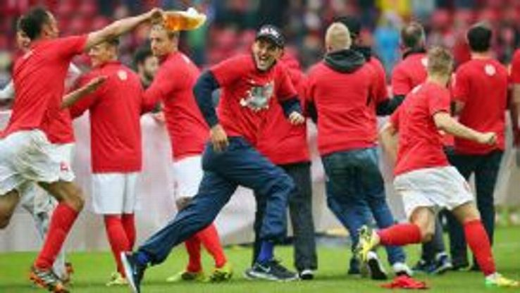 Thomas Tuchel joins in the postseason celebrations after Mainz's victory over Hamburg on Saturday.