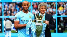 Captain Vincent Kompany and manager Manuel Pellegrini with the Premier League trophy.
