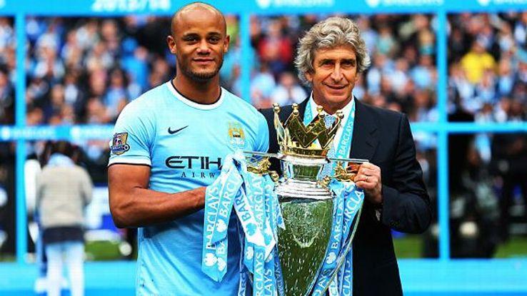 Captain Vincent Kompany and manager Manuel Pellegrini with the Premier League trophy.
