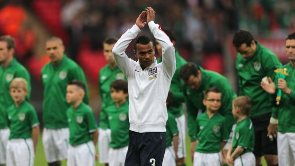 Ashley Cole applauds the fans before he is presented with his commemorative 100th England cap.