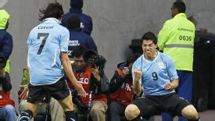 Edinson Cavani and Luis Suarez celebrate against South Korea in the 2010 World Cup finals.