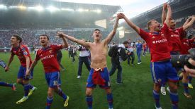 CSKA Moscow's players celebrate retaining the Russian Premier League title.