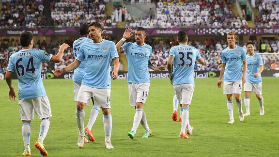 Marcos Lopes is congratulated on opening the scoring for Manchester City.