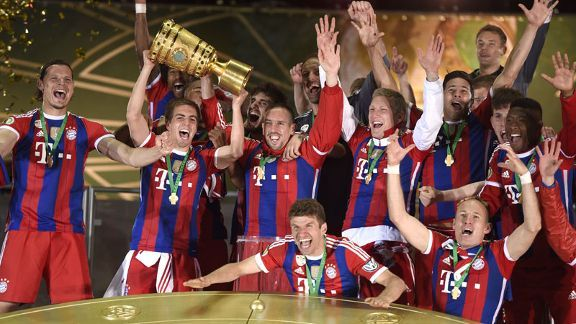Bayern Munich captain Philipp Lahm hoists the DFB-Pokal trophy aloft in Berlin.