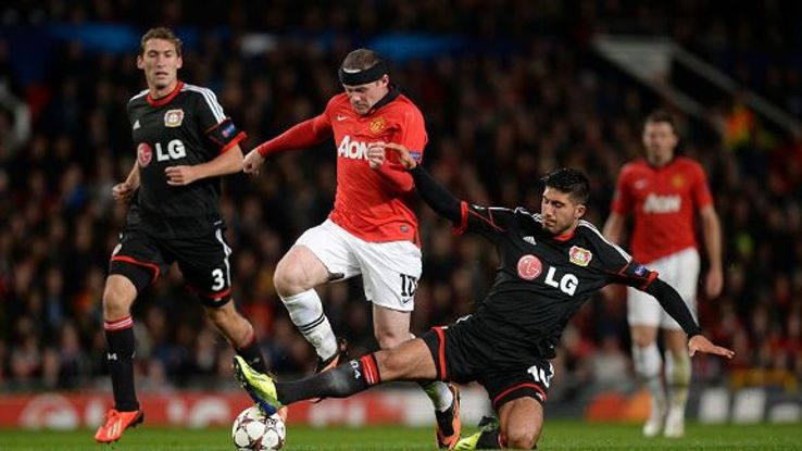Liverpool target Emre Can challenges Wayne Rooney for the ball during the Champions League group stages.