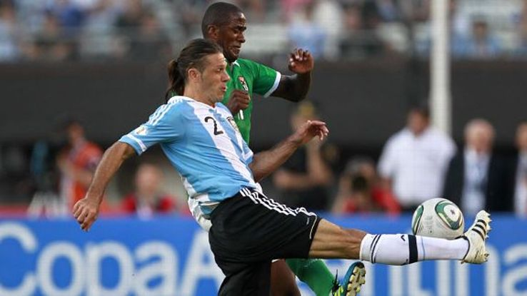 Martin Demichelis in action for Argentina against Bolivia in 2011.