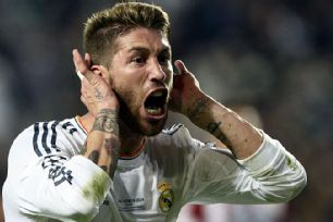 Sergio Ramos celebrates after levelling for Real deep into stoppage time.