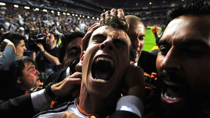 Gareth Bale is mobbed after his goal completed Real Madrid's comeback against Atletico.