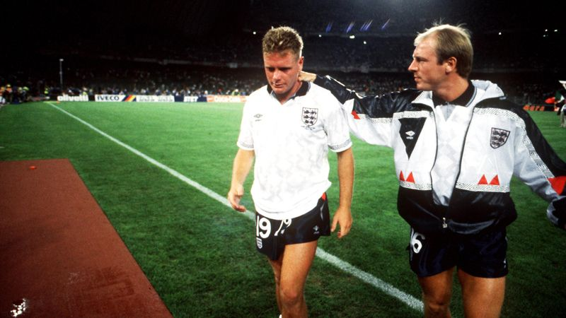 England's Paul Gascoigne (l) is consoled by teammate Steve McMahon (r) after their defeat on penalties to West Germany in 1990.