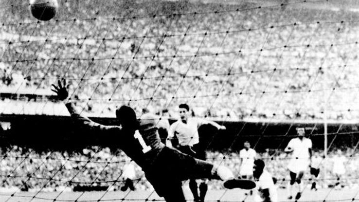 Uruguayan forward Juan Alberto Schiaffino (C) scores the equaliser past Brazilian goalkeeper Moacyr Barbosa.