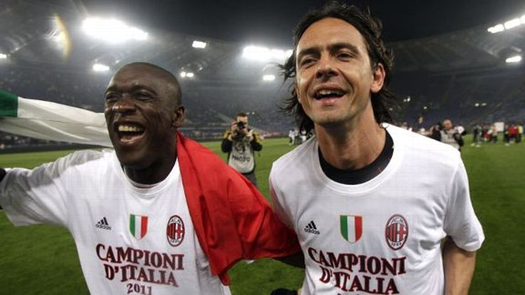 Clarence Seedorf celebrates with former AC Milan teammate Filippo Inzaghi in 2011.