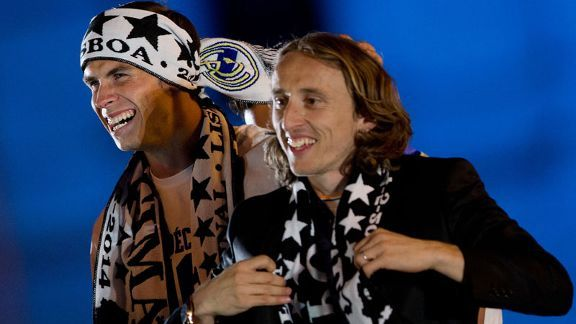 Bale and Modric celebrate Real Madrid's Champions League triumph.