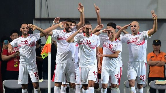Zouhaier Dhaouadi (left) celebrates his goal for Tunisia against a lacklustre South Korea side.