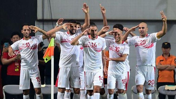 Zouhaier Dhaouadi (left) celebrates his goal for Tunisia against a lacklustre South Korea side.