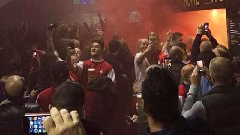 Arsenal fans with smoke bombs.