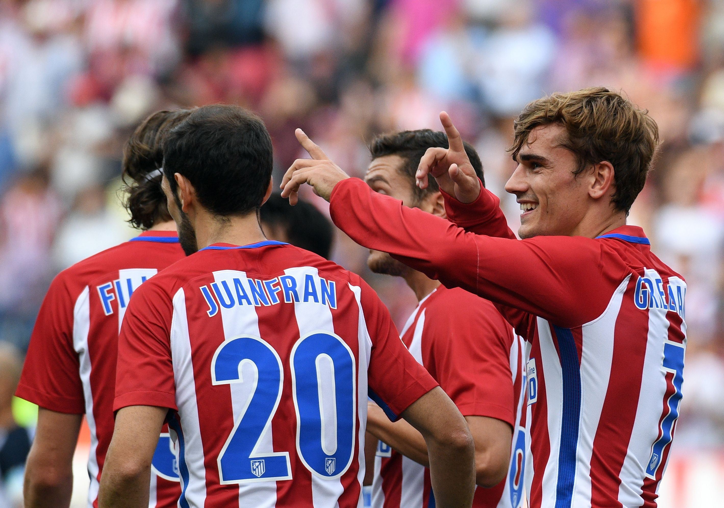 Antoine Griezmann, right, celebrates during the La Liga match between Atletico Madrid and Deportivo La Coruna at the Vicente Calderon on September 25, 2016 in Madrid, Spain. (GERARD JULIEN/AFP/Getty Images)