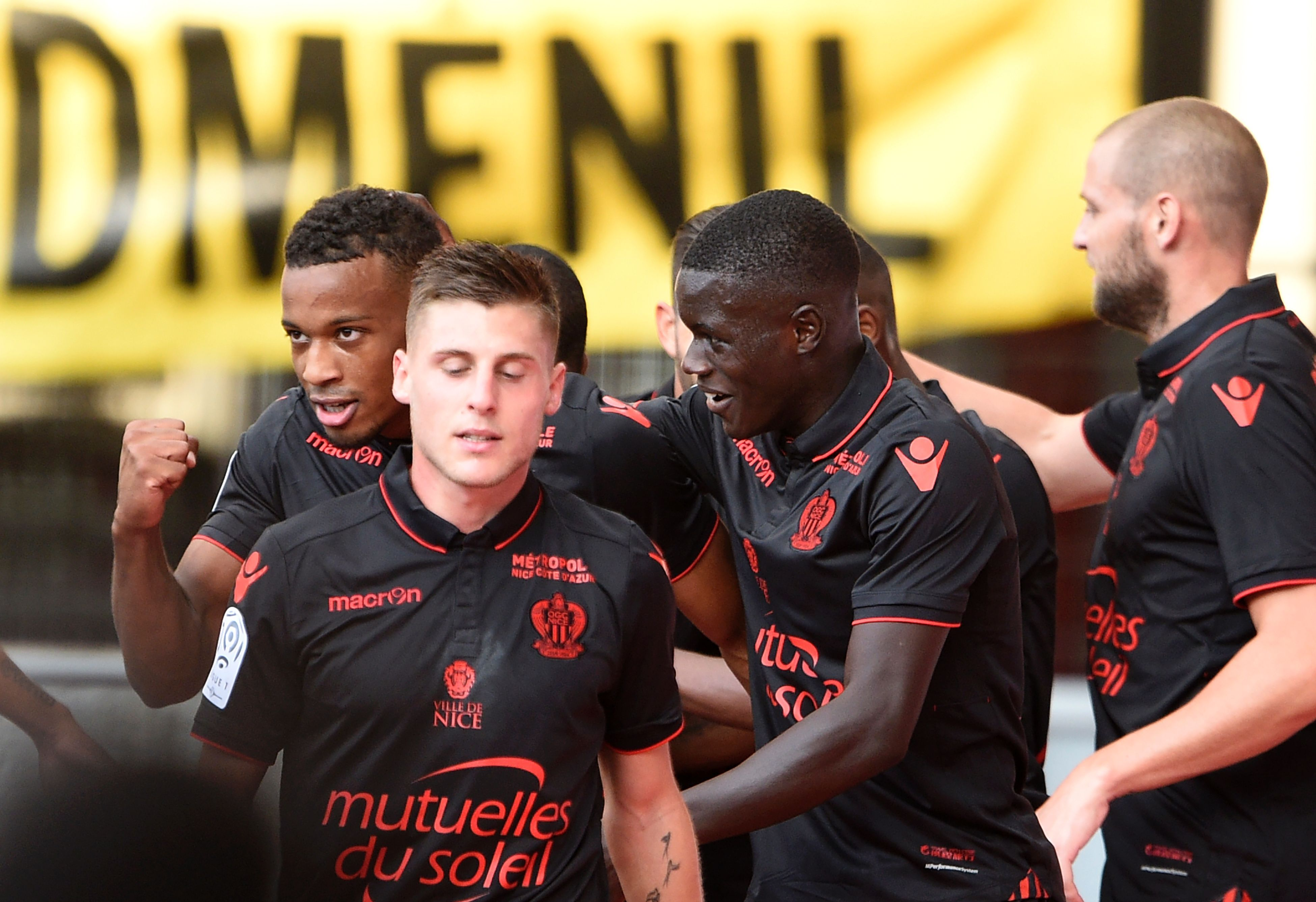 Nice players celebrate after scoring a goal in a Ligue 1 win versus Nancy.