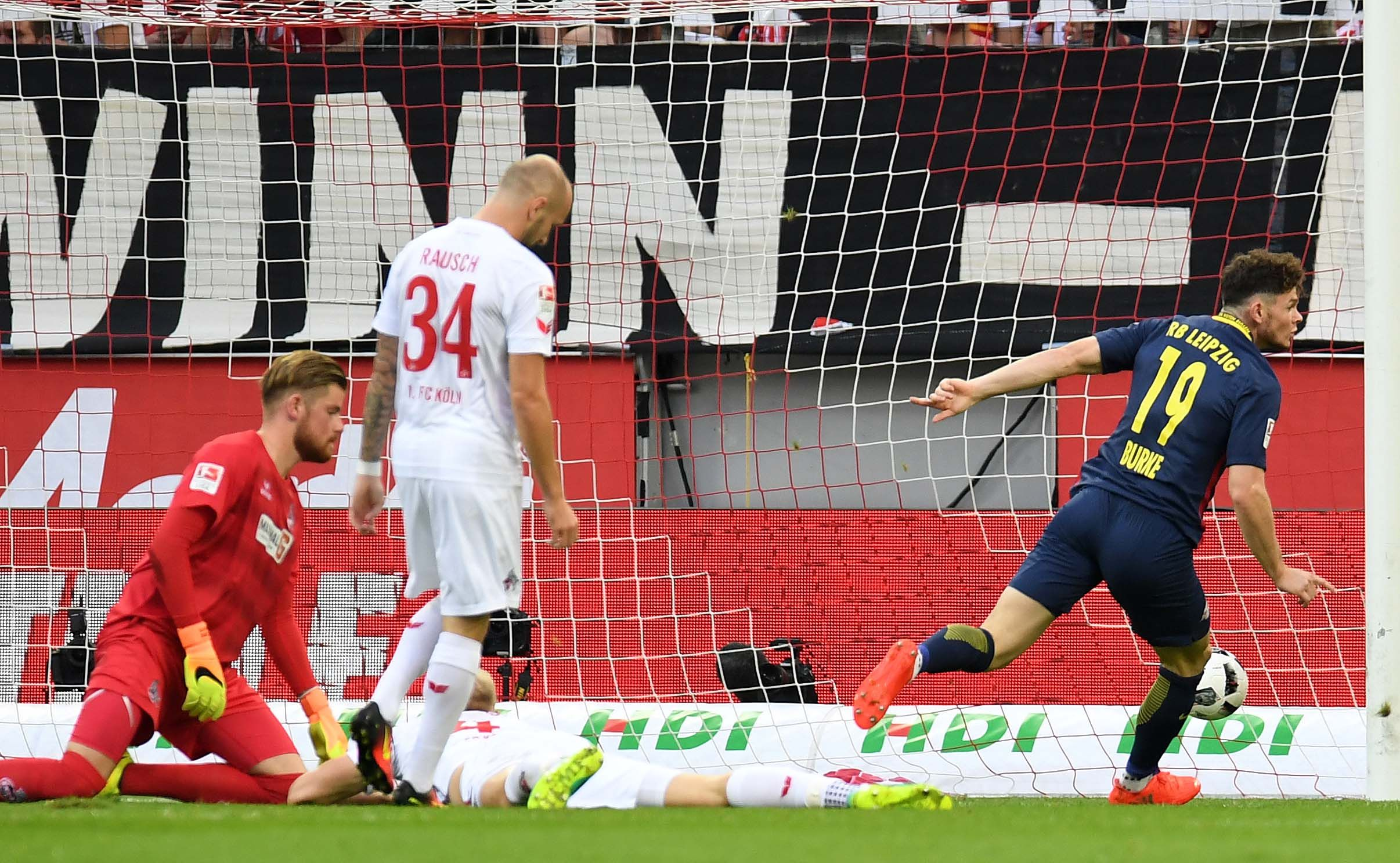 Oliver Burke celebrates giving RB Leipzig the lead against Cologne.