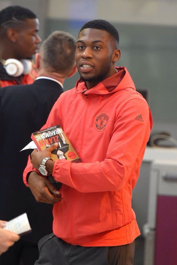 Tim Fosu-Mensah carrying Zlatan Ibrahimovic's book