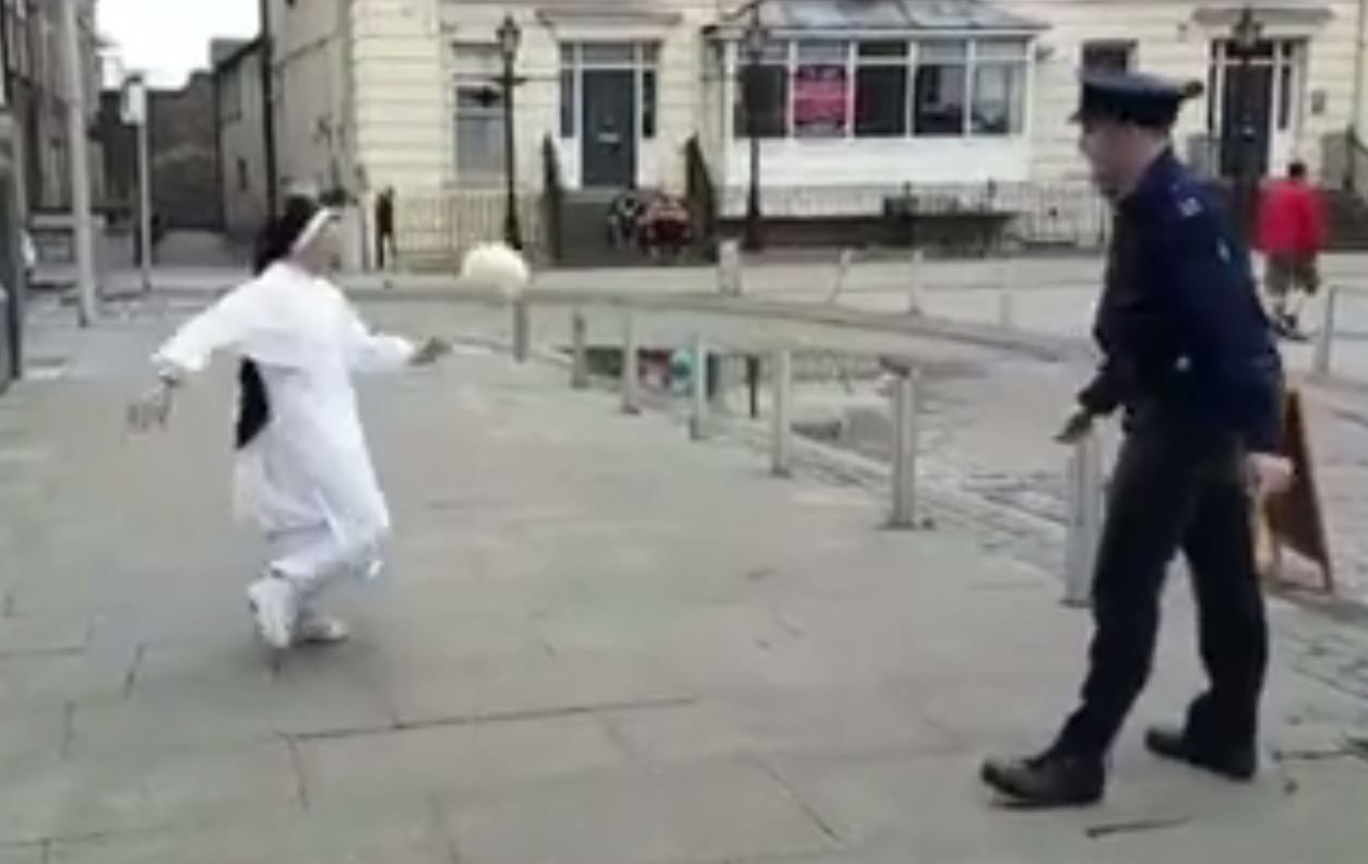 Nun and policeman play keepy-uppy